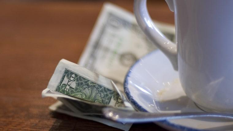 dollar bills under a coffee cup; Shutterstock ID 6513259; PO: Brandon for Food