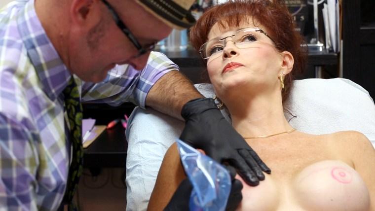 Vinnie Myers tattoos a nipple on breast cancer survivor Robin Denny