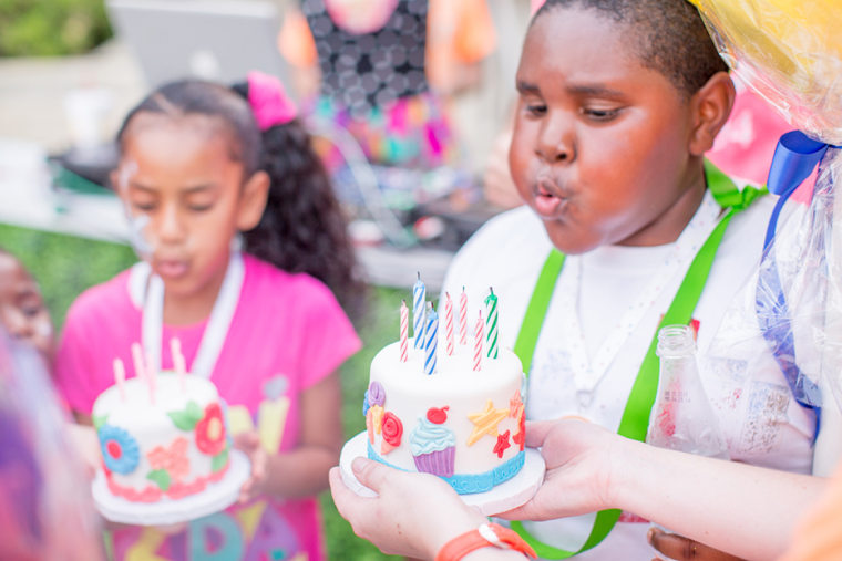 Homeless children blow out their birthday candles in Dallas.