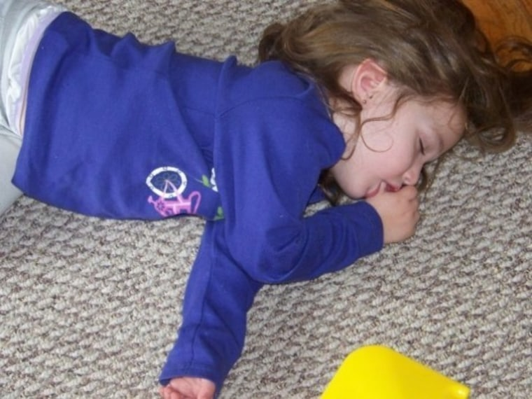 Little girl passed out on carpet