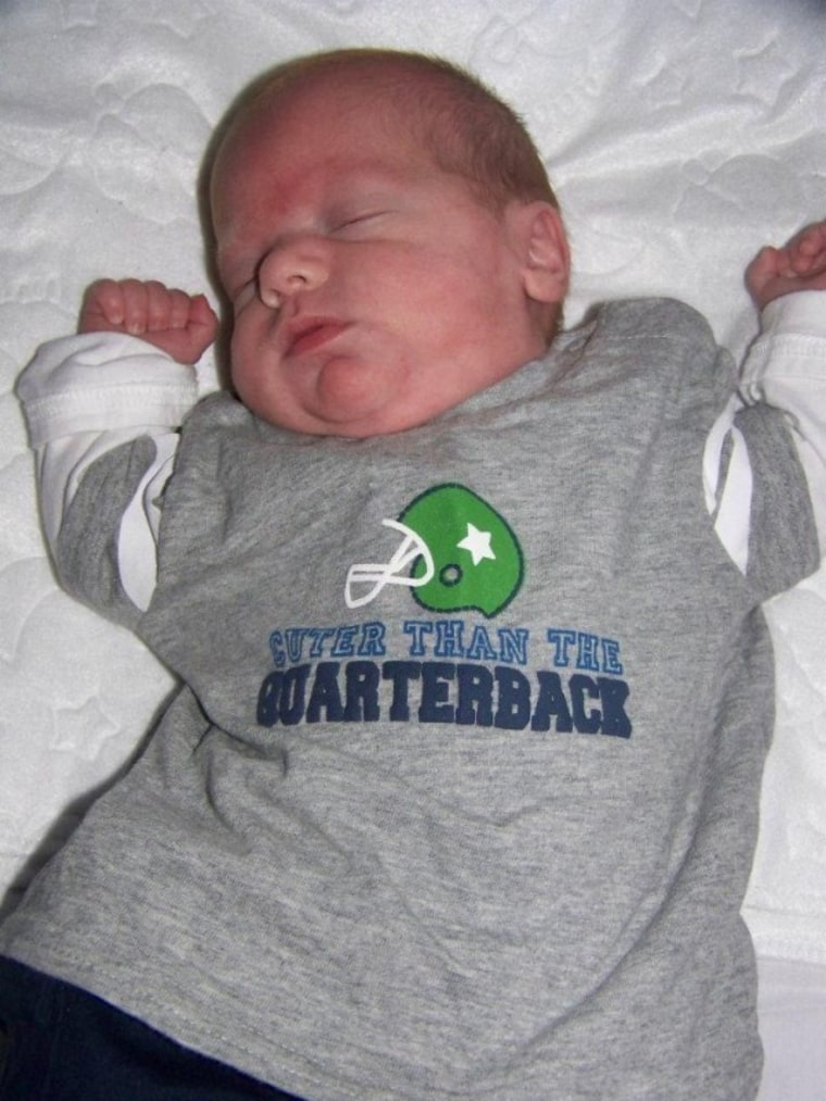 Baby sleeping in quarterback T-shirt