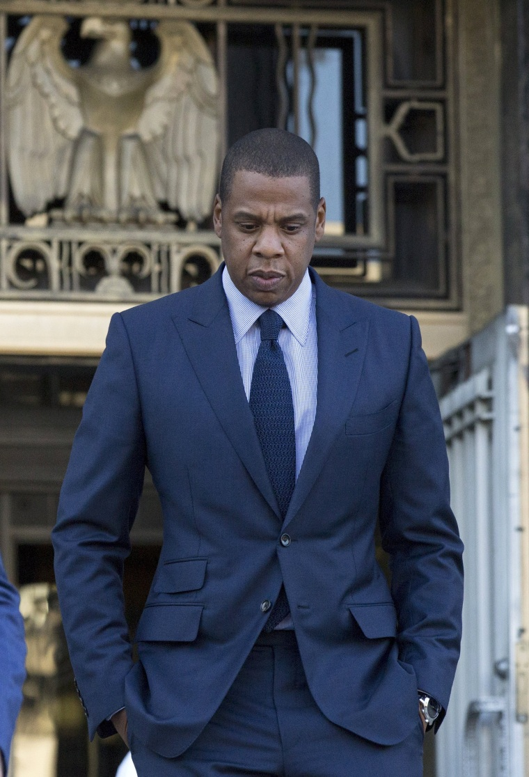 Image: Rapper Jay Z leaves a United States District Court after opening statements and jury selection in downtown Los Angeles