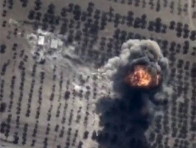 Image: Frame grab taken from Russia's Defence Ministry footage shows explosion in Idlib province, Syria