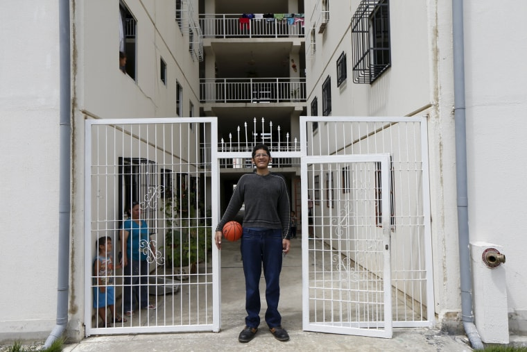 Image: Jeison Rodriguez (C), 19, the living person with the largest feet in the world, poses for a picture at his house in Maracay, Venezuela