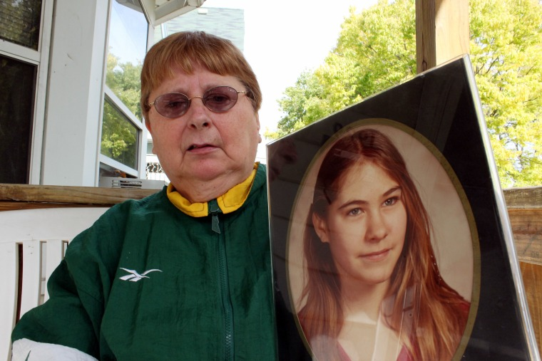 Image: Carolyn Tousignant with photo of her daughter, Carrie Ann Jopek
