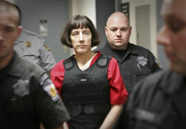 IMAGE: Amy Bishop in custody in 2010