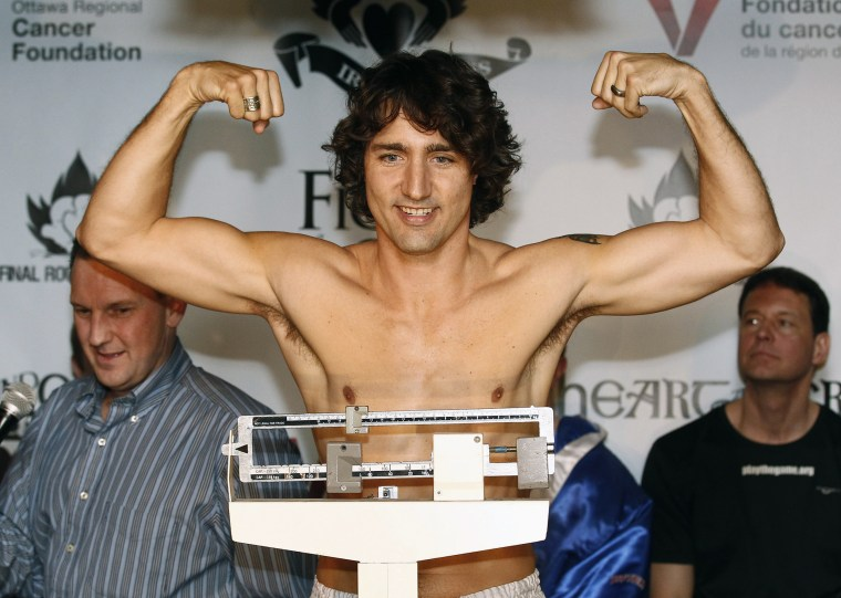 Liberal MP Trudeau gestures while weighing-in for a charity boxing match in Ottawa
