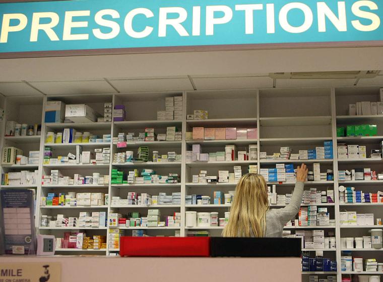 pharmacist stocks shelves