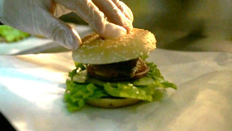 Image: A cook prepares a duck burger