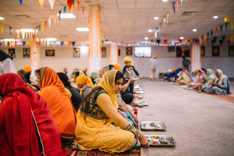 A woman eats food at the langar at the Sikh Temple in Richmond Hill, Queens on Sunday, October 11th 2015.