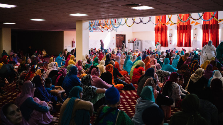 Sikh women pray in the large temple area at the Sikh Temple in Richmond Hill, Queens on Sunday, October 11th 2015.