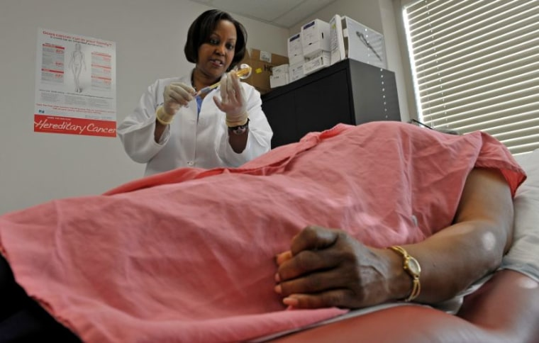 LANHAM, MD- MARCH 15 Dr. Regina Hampton prepares to insert a balloon catheter into a patient's breast for radiation treatment in Lanham, Maryland on March 15, 2012. Dr. Regina Hampton is a breast surgeon and medical director of Signature Breast Care in Lanham, Maryland. Photos for the Black Women series about breast cancer awareness. (Photo by Marvin Joseph/The Washington Post via Getty Images)
