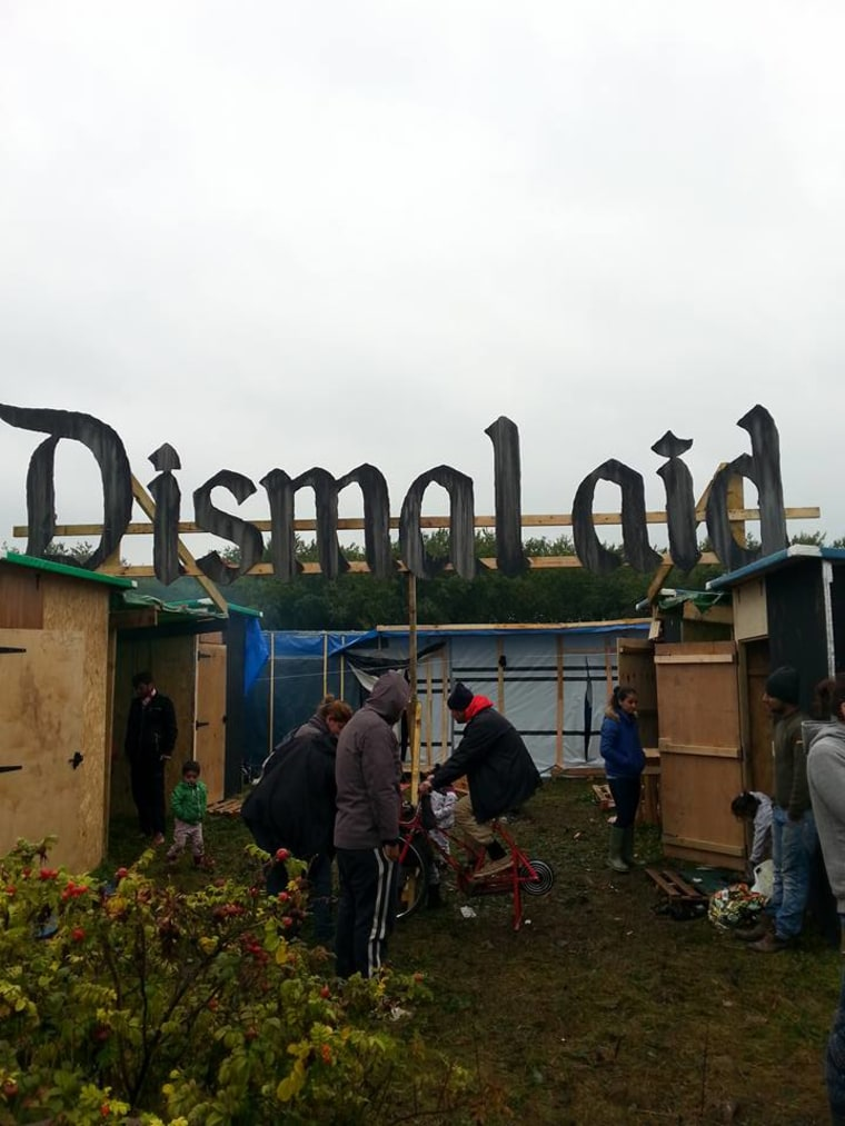 "The ""Dismaland"" sign was altered to spell out ""Dismal aid"" — but it was later torn down."