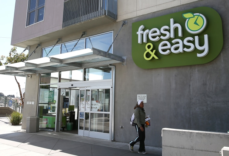 Image: A customer leaves a Fresh and Easy grocery store in San Francisco