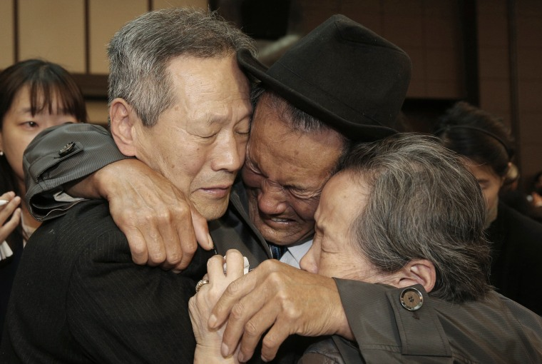 Image: North Korean Son Kwon Geun, center, weeps with his South Korean relatives