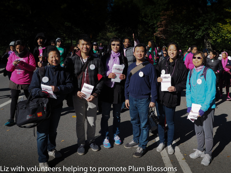 Elizabeth OuYang and volunteers help promote Plum Blossoms during the Making Strides Against Breast Cancer March in Central Park, October 18, 2015.