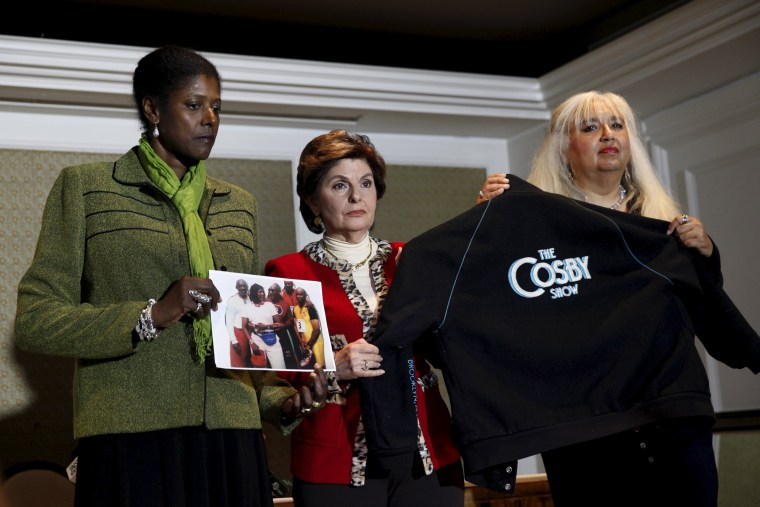 Image: Attorney Gloria Allred stands with two women who allege that they were assaulted by actor and comedian Bill Cosby at a news conference in New York