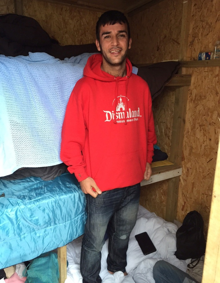 Image: Hawar, 25, a student from Iran, is living in a shelter built from Banksy's recent exhibition.