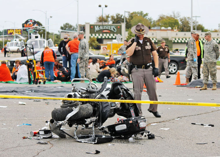 A driver mowed into an Oklahoma State University homecoming parade in Stillwater Saturday, killing four and injuring 47.