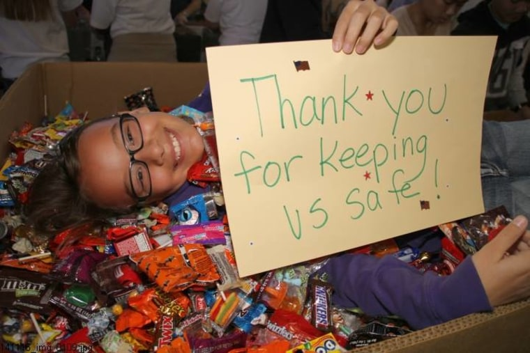 A happy donor to Operation Gratitude, which sends Halloween candy to military service members serving overseas.