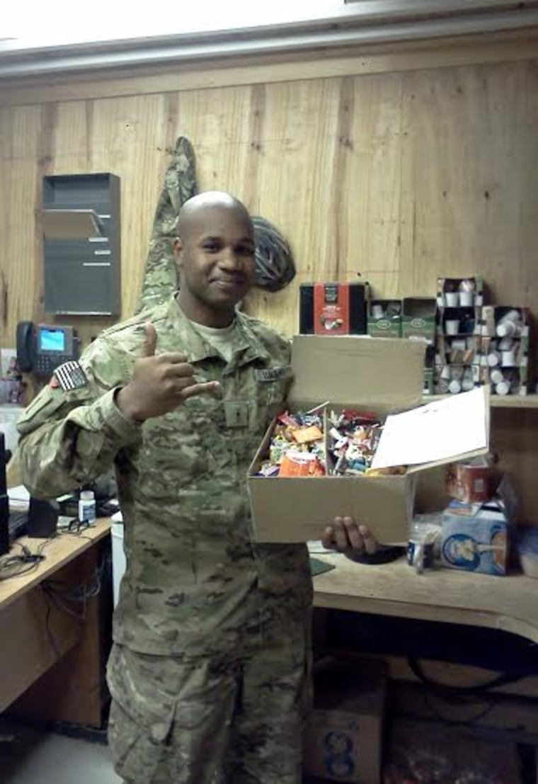 ...And a very happy recipient of an Operation Gratitude candy care package.