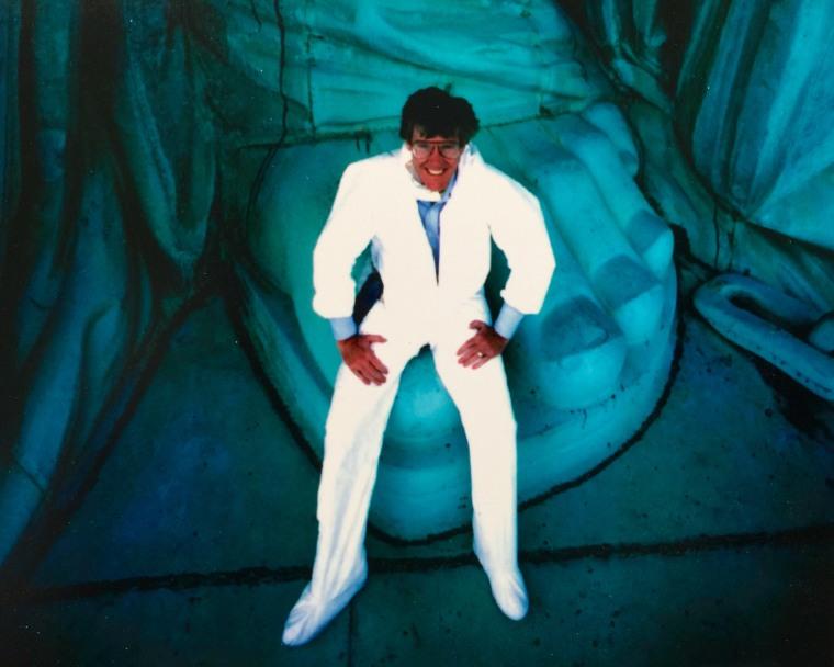 Bob Dotson sitting on the Statue of Liberty's big toe, 1984