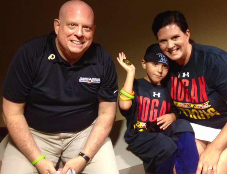 Maryland governor Larry Hogan with Andrew Oberle and his mother, Caroline.