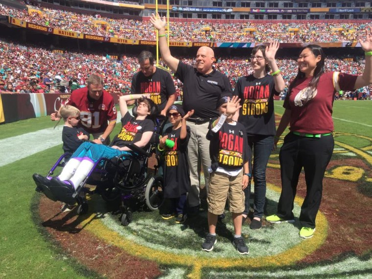 Hogan and daughter, Jaymi, joined pediatric cancer patients and their families on the field at a Washington Redskins game in September. It was at this game that Andrew Oberle (center) presented the governor with a list of tips for battling cancer.