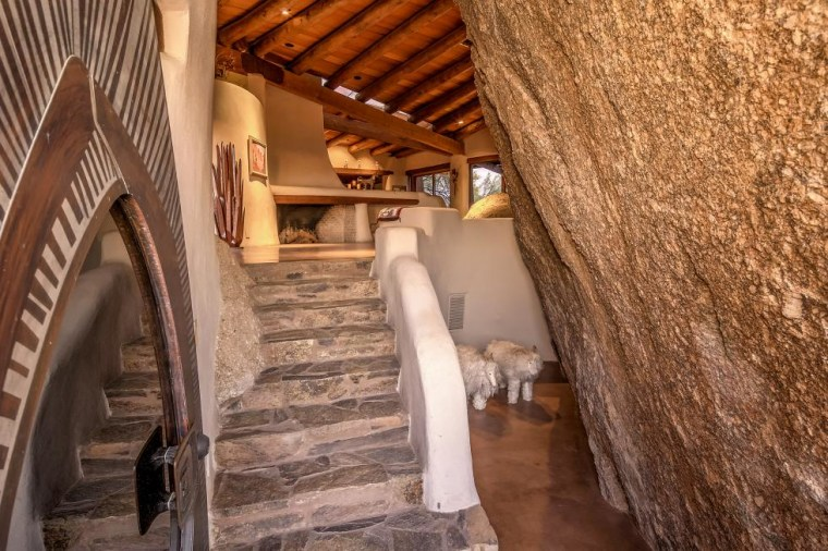 The 'boulder house' contains ancient rock carvings and is for sale
