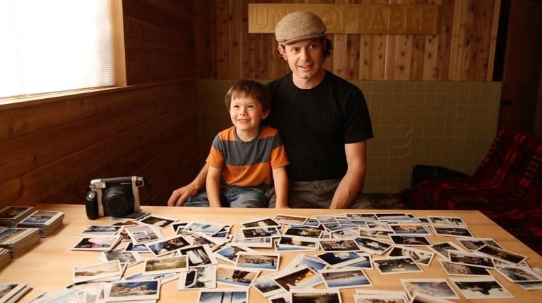 Five-year old photographer Hawkeye huey and his dad Aaron Huey
