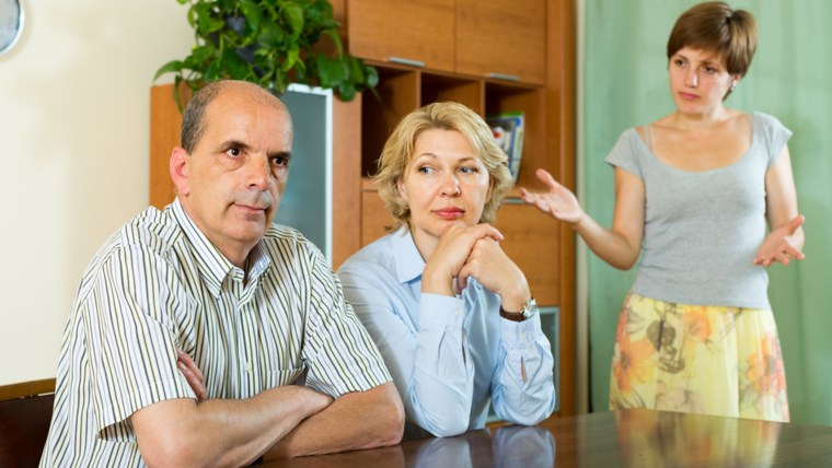 Adult daughter having serious talking with mature parents at home ; Shutterstock ID 205697506; PO: today.com