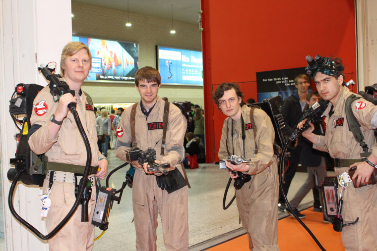 "Attendees dressed as characters from ""Ghostbusters"" pose with proton packs at MCM Comic Con in London."