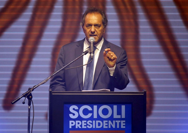 Image: Argentina's ruling party candidate Daniel Scioli talks to supporters after elections in Buenos Aires