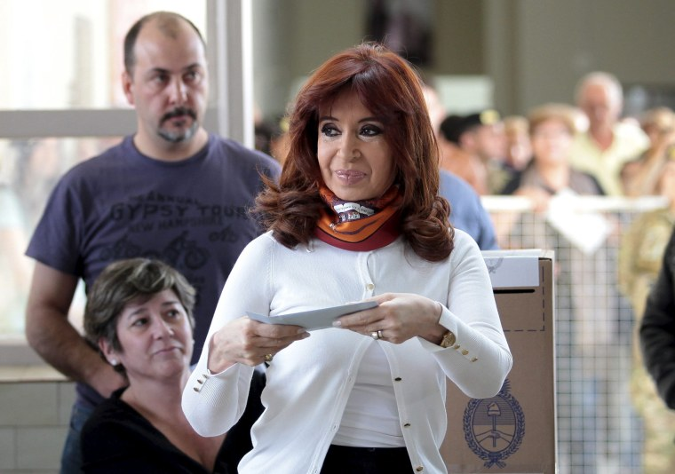 Image: Argentina's President Cristina Fernandez de Kirchner casts her vote at a polling station in Rio Gallegos