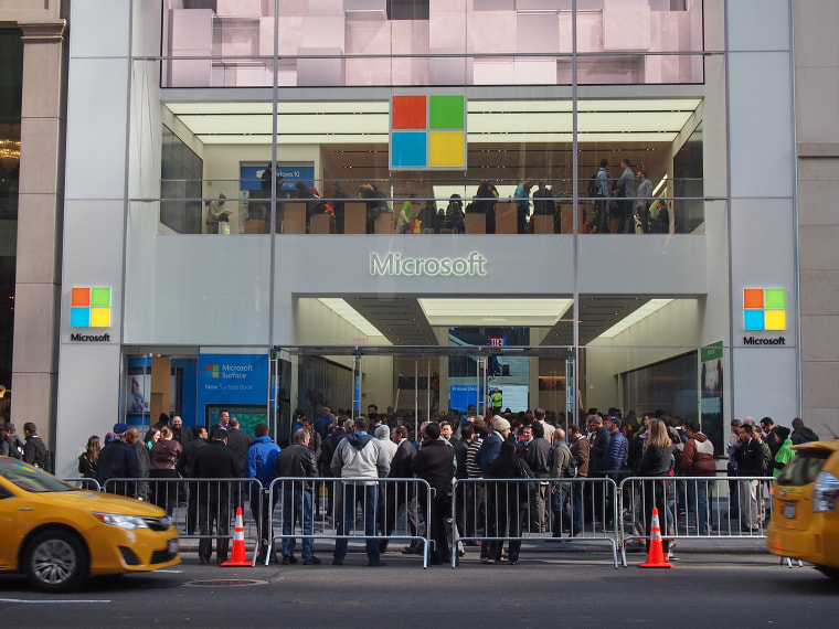 People wait outside the Microsoft flagship store on its opening day.