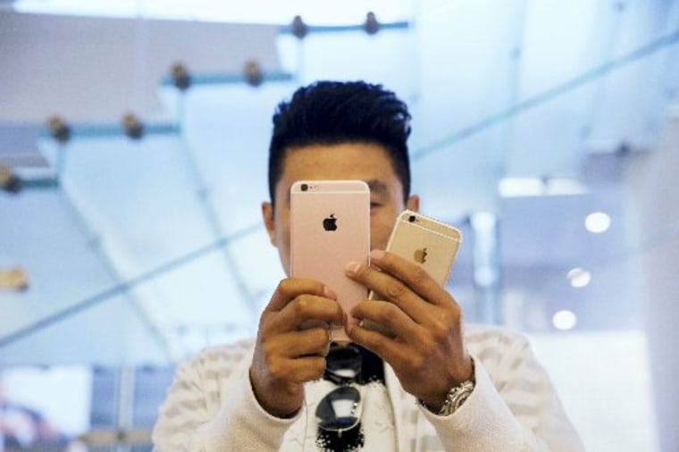 Image: iPhone 6s and 6s Plus go on sale at an Apple store in Beijing