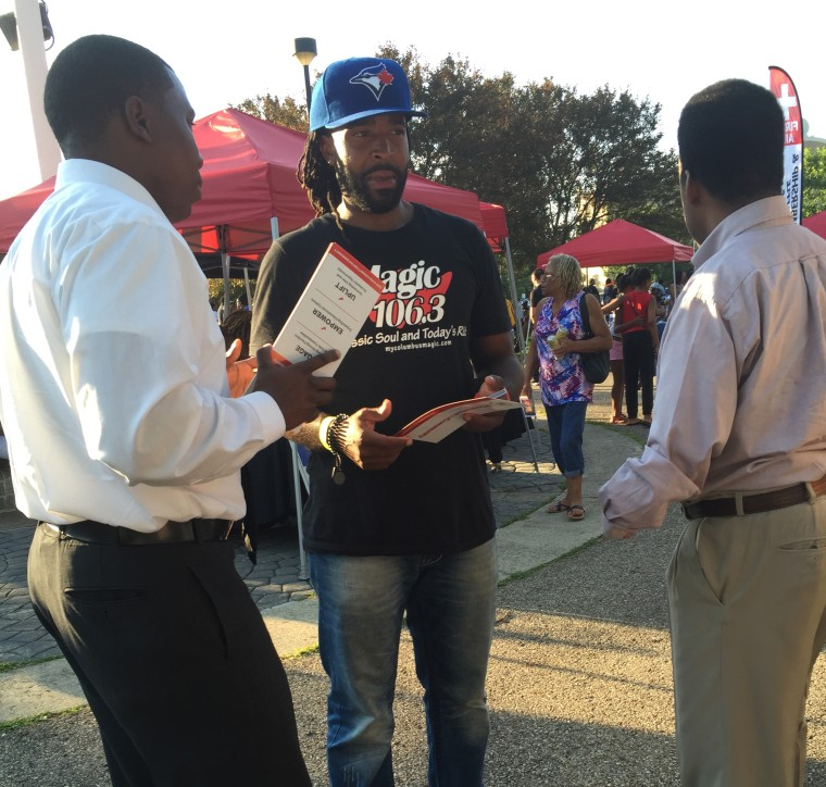 At the Heritage Concert Series in Columbus, Jeff Pastor, RNC Co–Director of African American Strategic Initiatives in Ohio, distributes #CommittedToCommunity palm cards to voters and collects their feedback.