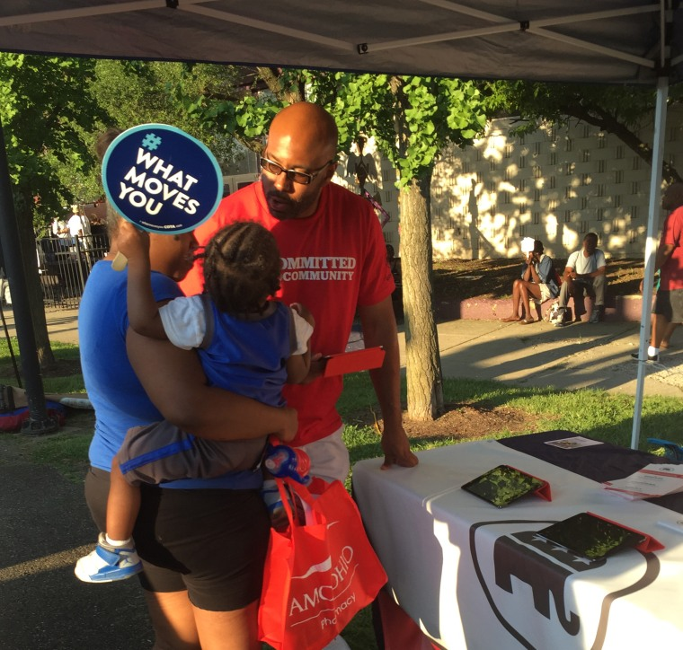 At Family Zoo Day in Cleveland, Brian Barnes, RNC Co–Director of African American Strategic Initiatives in Ohio, gathers feedback from a voter about the issues that matter most to her family.