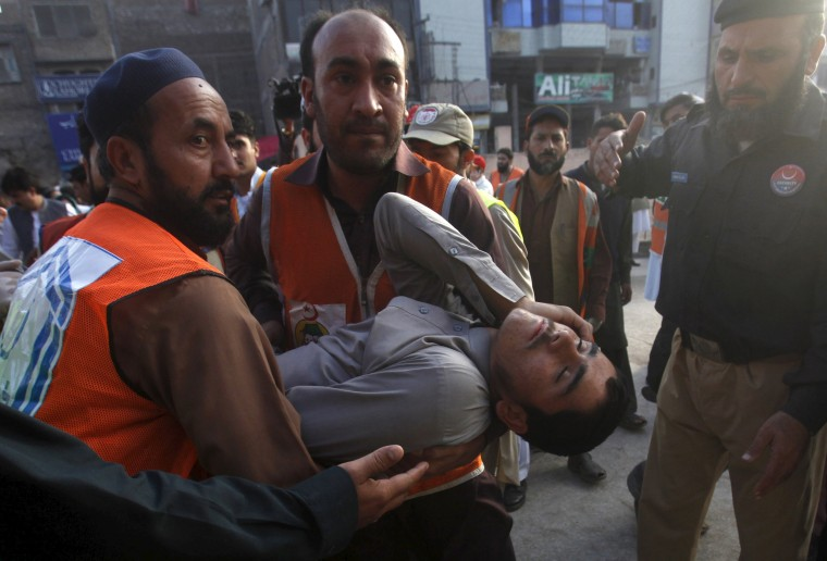 Image: Rescue workers carry an injured man