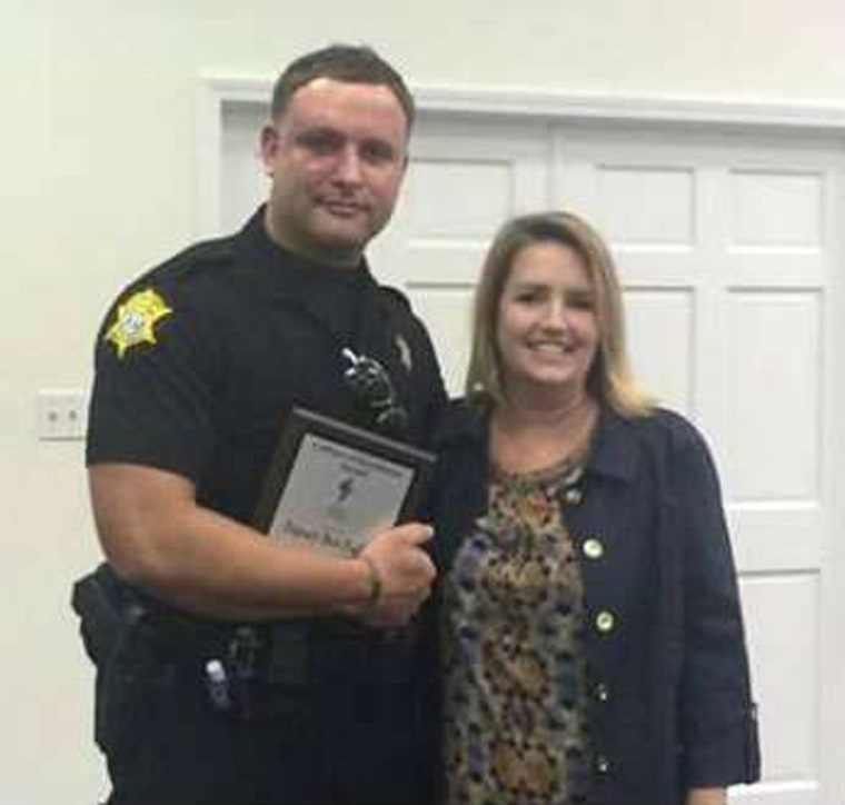 Image: Richland County Sheriff's Department Officer Senior Deputy Ben Fields is pictured with Karen Beaman, Principal of Lonnie B. Nelson Elementary School in Columbia South Carolina