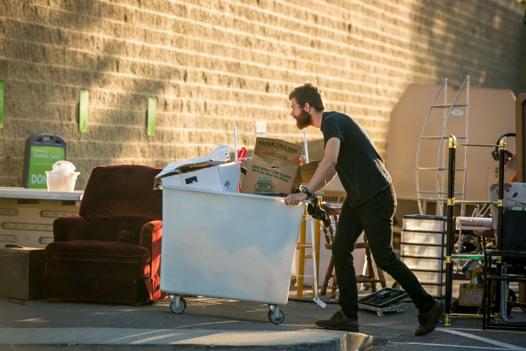 Photo: Worker pushes cart of donated goods into a Value Village store in Bellingham,Washington.