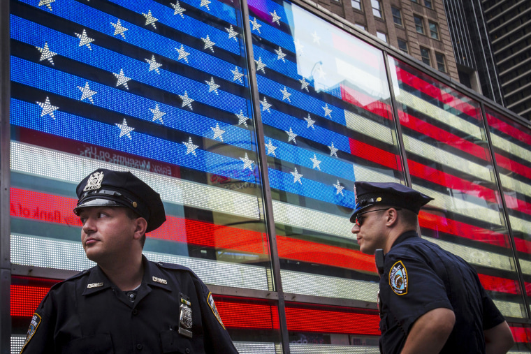 Image: Police officers patrol Times Square in New York