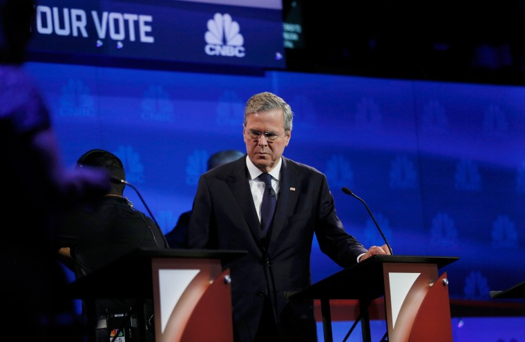 Image: Jeb Bush pauses at his podium during a commercial break
