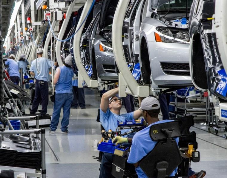 Workers assemble Volkswagen Passat sedans