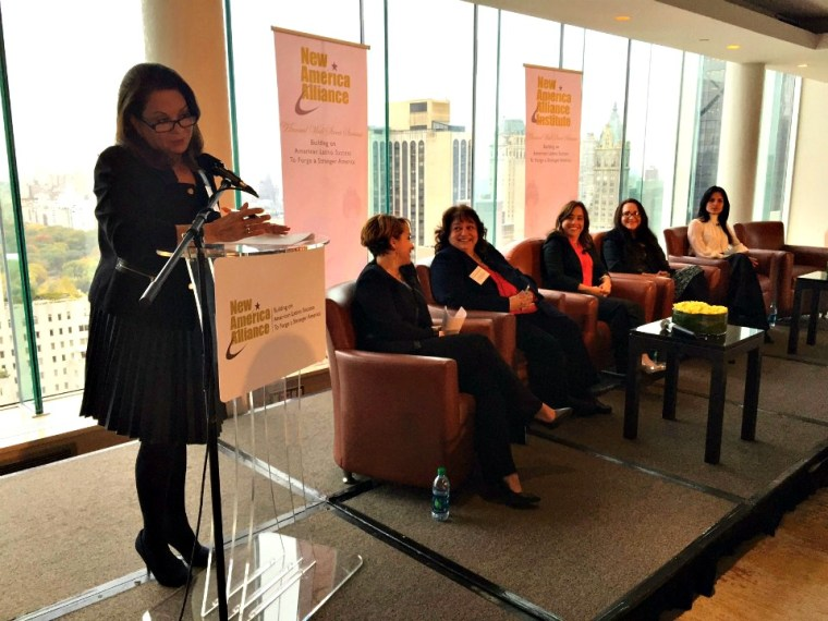 Ana-Maria Fernandez-Haar, NAA Latina Caucus Co-Chair (at podium) leads a panel of Latina leadership and economic force.