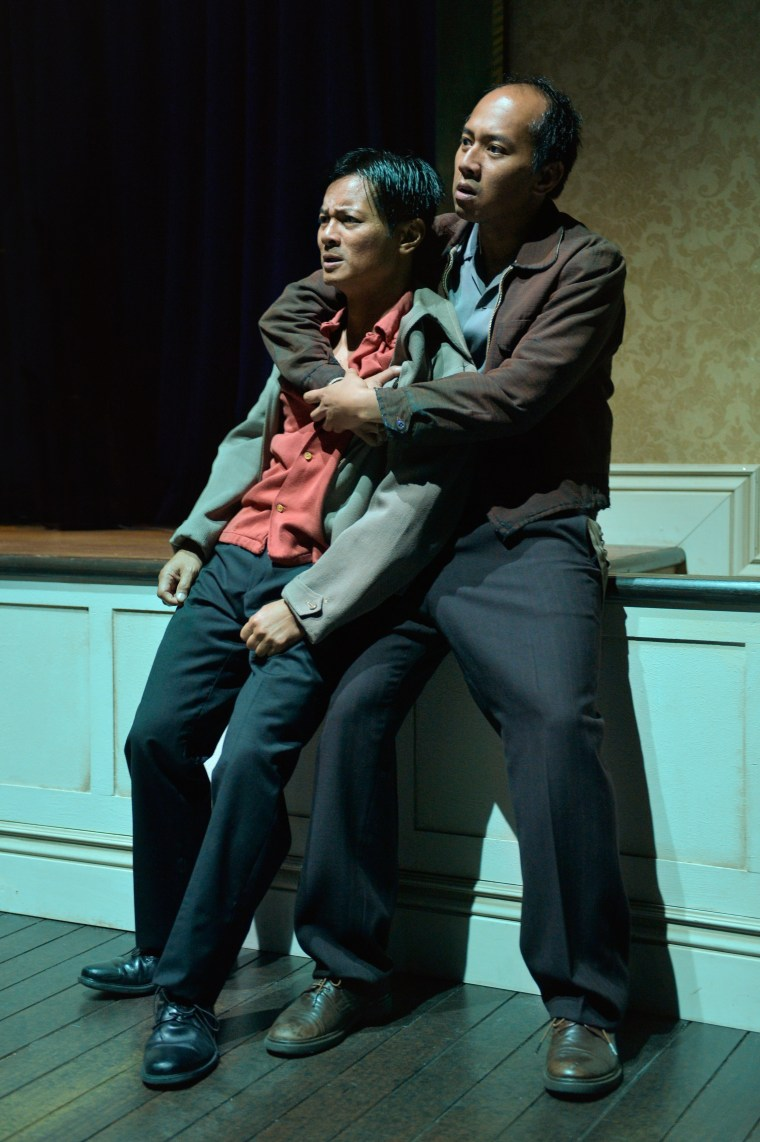 """Fortunado """"Nado"""" Giron (Jomar Tagatac, right) comforts Vicente Pacram (Ogie Zulueta, left) in """"Remember the I-Hotel,"""" a one-act play by Philip Kan Gotanda adapted from """"Monstress,"""" Lysley Tenorio's collection of short stories."""