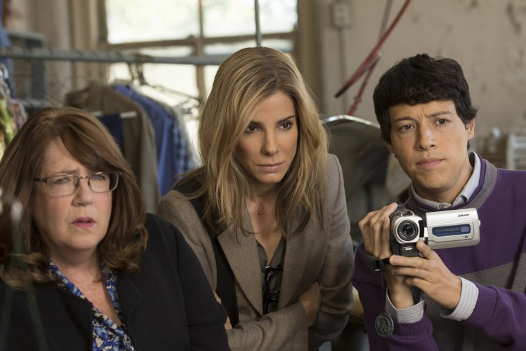 """Ann Dowd, Sandra Bullock, and Reynaldo Pacheco in """"Our Brand Is Crisis""""."""