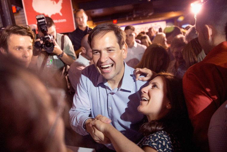 Image: Marco Rubio greets guests gathered for a campaign event