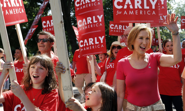 Image: Carly Fiorina waves during a Labor Day parade