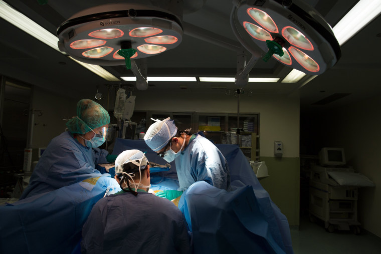Image: A doctor performs a transgender operation